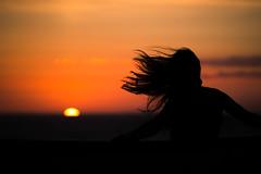 Waiting for the sun(set) (Explored) (_ranhada) Tags: sunset silhouette sea sun orange hair wind sunsetcolors woman sky vintagelenses manuallenses legacylenses nikkorpc105mmf25
