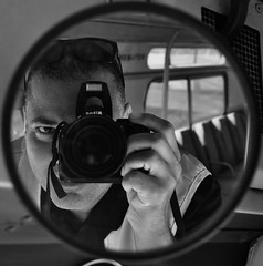 Focus On You For a While (Blue Rave) Tags: blackandwhite bw nikon mirror reflection bus transportation transit publictransport coach transport motorcoach oldmodelbus backofthebus flxible vintage metro interior d5000 camera bloke dude ego guy male mate me people self photography myself selfie selfportrait takingaphoto nikond5000 photographer closeup electronics lens angle angles seat seats maninthemirror framed picturesinaframe frame pictureframe photoborder framedportraits outoffocus