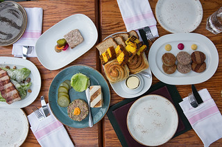 Our appetizers: Caesar Salad, Pork Terrine, Steak Tartare, Bread, Sausages