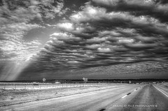 The Spilling of Rays (Chains of Pace) Tags: weather blackandwhite clouds road rays landscape oklahoma travel