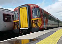 Gatwick Express at Speed. (ManOfYorkshire) Tags: class442 wessex electric multiple unit threebridges station platform yellowline fast speed racing express gatwick govia thirdrail brightonmainline reflection puddle water