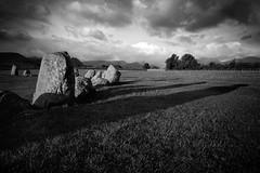Castlerigg Stone Circle (Claire Willans) Tags: clouds old blackandwhite monochrome england shadows moody ancient heritage lakedistrict cumbria keswick fells religion dark stones castleriggstonecircle stonecircle castlerigg druid