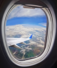 Clouds and sky as seen through window of an aircraft (marozn) Tags: aerial air aircraft airliner airplane atmosphere aviation blue cloud cloudscape day earth flight fly ground height high journey land landscape machine plane scenic sky tranquil transport transportation travel trip vehicle view wing window illuminator weather background outdoor sunlight sun cloudy glass heaven top banner