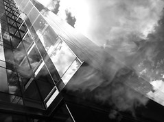 Rise (dcemmy) Tags: city light shadow sky urban blackandwhite bw reflection building apple lines architecture clouds facade contrast skyscraper dark washingtondc dc experimental perspective structure conceptual iphone foggybottom vornado farragutwest mobilephotography emilyreid iphone4 iphoneography snapseed