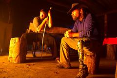 Masters and Carroll (Deetrak) Tags: fireplace glow leg veteran amputee prosthetic