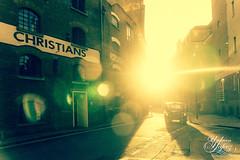 Taxi (Umbreen Hafeez) Tags: life lighting street city uk travel light england london car silhouette back alley europe streak bokeh taxi flare gb backlighting blacklighting spiritofphotography
