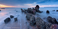 Rocks in the swell (Louise Denton) Tags: longexposure sunset rocks glow nt australia darwin bluehour northernterritory mindilbeach