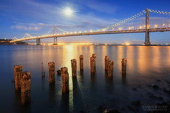 The Silvery Moon (Aaron Reed Photography) Tags: sanfrancisco california light moon reflection reflections photography photographyclass photographers baybridge stockphotos moonlight pilings stockimages professionalphotography blackwhitephotography photographyschool fineartphotographs thebayarea thebaybridge skyphotographs lakephotographs aaronreed naturephotographs abstractphotographs landscapephotographs photographytraining framedartprints sunsetphotographs artphotographs sunrisephotographs aaronreedphotography surrealphotographs redphotographs waterphotographs cityscapephotographs cloudsphotographs duskphotographs reflectionphotographs exposurenorthwest bluephotographs aaronreedlandscapephotographer aaronreedphotographer landscapephotographygallery mountainsphotographs orangephotographs pavementphotographs whatislandscapephotography whatisstockphotography aaronreedart aaronreedprints aaronreednature aaronreedaluminumartprints yellowphotographs bridgephotographs buildingsphotographs twilightphotographs roadphotographs aaronreedmetalprints aaronreedacrylicfacemountprints