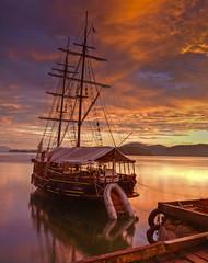 Sunrise Vessel (Aubrey Stoll) Tags: wood brazil costa verde southamerica water riodejaneiro paraty clouds sunrise pier boat ship parati hills mast ropes portuguese tropics dingy trindade riveroffish serrabocana