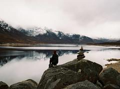 (CharlieReynolds) Tags: wild cloud snow mountains 120 film ice water girl rock mediumformat scotland highlands scottish clear highland loch wilderness natue balancingstones pentax67 kodakportra400 cluanie pentax90mmf28takumar