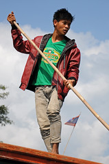 Working the Mekong (Oliver J Davis Photography (ollygringo)) Tags: travel man work river person boat nikon asia southeastasia flag working bamboo pole laos barge mekong beerlao d90 2013 laosflag mekongregion