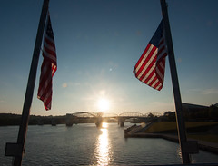 Sunrise on the Tennessee River. (rpennington9) Tags: river rivers flags reflections water bridges nikon nikond90 sunrise americanflags marketstreetbridge
