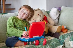 Four year old boy sitting with teddy bear (Tonya B4) Tags: 4 age background bear boy caucasian child childhood children close compuer cute day education enjoyment face four fun happiness happy hobbies kid kids learning little looking male old picture portrait red share smile smiling teddy toy up white year years young computer italy