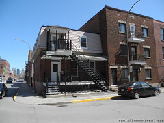 Small duplex on St-Antoine (Vanishing Montral) Tags: history villedemontreal montreal histoire photography art architecture demolition disappearinghistory newconstruction