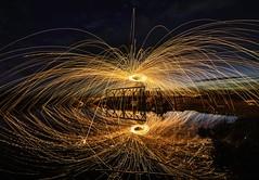 Spinning Fire (Toby Jones Photography) Tags: water reflection longex light fire sunset lastlight clouds sky nikon nikond3200 england dorset