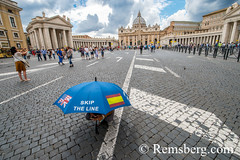 Rome, Italy- Tourist with an umbrella with an exterior view of (New) St. Peter's Basilica in the background located in Vatican City (an enclave of Rome). Begun by Pope Julius II, St. Peter's is dedicated to the Apostle Peter and is built in the form of a (Remsberg Photos) Tags: europe italy rome ancient ancientcivilization roman architecture buitstructure tourist sightseeing photography history historical internationallandmark capitolcity romaprovince ancientrome art church religion basilica stpetersbasilica newstpetersbasilica vaticancity pope popejuliusii apostle pilgrimage michelangelo peter renaissance baroque umbrella ita