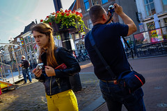 If looks could kill (Gouda, Netherlands) (PaulHoo) Tags: gouda holland netherlands fuji x70 city urban 2016 candid streetcandid streetphotography looks girl angry furious mean expression look yellow vibrant color