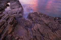 Untitled (Ivan Galic) Tags: sea coast rock twilight pattern shore stone longexposure pebbles sunset pink purple violet colorful
