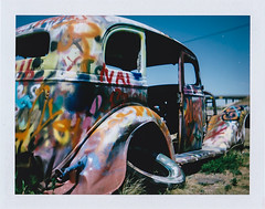 untitled (Eric Baggett) Tags: analog film polaroid fujifp100c texas vwranch decay decaying hotrod car graffiti desolate rust brokendown polaroidlandcamera