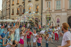 catch! (stevefge) Tags: krakow poland oldtown squares entertainers entertainment bubbles fun children kids kinderen boys girls summer zomer people candid street reflectyourworld