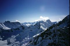 Niut Range 2002 (Dru!) Tags: blue sky cloud white mountain snow canada mountains spring bc britishcolumbia alpine niutrange coastmountains waddingtonrange plummerpeak rustypeak pagodapeak