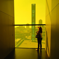 . (Ansel Olson) Tags: city light urban colour building tower window glass minnesota silhouette sign yellow architecture ed amber nikon downtown view floor minneapolis led architect vista 24 mm nikkor tinted f35 pce guthrietheater mylovelywife fritted d700 atelierjeannouvel