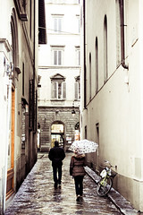 I'll stay 5 steps back and not breathe a word. ( rachelloooow) Tags: street italy woman man wet rain weather umbrella alley quiet silence drizzle