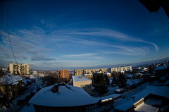 cloud around (Aleks G. Photography) Tags: city blue moon snow clouds view roofs