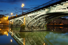 Triana Bridge Sevilla (Allard Schager) Tags: city longexposure bridge winter sunset beautiful architecture 35mm sevilla spain nikon december streetlights surreal arches seville andalucia illuminated le lanterns vista mirage bluehour brug andalusia breathtaking nationalmonument gettyimages spanje 2012 1845 puentedetriana 1852 guadalquivirriver trianabridge andalucie d700 impressiveview enfuse isabeliibridge nikond700 nikkor2470mmf28 nikonfx allardone allard1 fullframepower allardschagercom moorishrevivalchapel