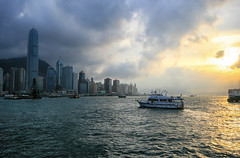 Victoria Harbor Sunset in Hong Kong (` Toshio ') Tags: china city sunset cloud sun mountain green water yellow hongkong harbor boat smog asia cityscape chinese boating starferry hongkongisland victoriaharbor toshio kowloonpeninsula