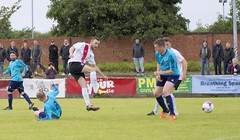 Jordan Shelvey gets a shot away despite the low challenge (Stevie Doogan) Tags: clydebank glasgow perthshire exsel group sectional league cup wednesday 10th august 2016 holm park