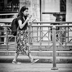 Multitasking (tim-wolverson) Tags: woman female lady mobile walking streetphotography blackandwhite lille france multitasking