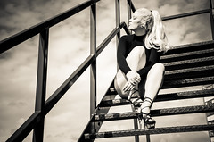 Escape (sophie_merlo) Tags: bw blackandwhite mono monochrome stairs staircase fireescape escape height blonde ponytail sexy legs heels ink inkedmodel model woman sun clouds lines city