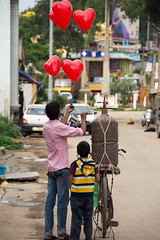 hope floats (Free As I Can Be) Tags: bangalore streets red balloons seller kids india
