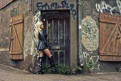 A door (DZ-fotografia) Tags: sexy pvc raincoat shiny lady woman street door boots black blonde long hair helsinki vallila