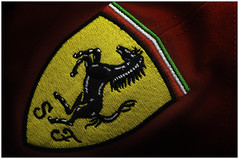 Macro Mondays  Planes, Trains & Automobiles - Ferrari (Explore 6th Sep 2016) (andymoore732) Tags: macromondays planestrainsautomobiles planes trains automobiles macro mondays ferrari scuderiaferrari scuderia badge logo prancing horse prancinghorselogo red italian sportscar racing clothing andy moore colour nikon d300 afs vr micronikkor 105mm f28gifed challenge theme flickr planestrainsandautomobiles