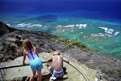Kids Atop Diamond Head (AntyDiluvian) Tags: hawaii 2001 30thanniversary oahu honolulu diamondhead cone volcaniccone trail summittrail diamondheadstatemonument top kids lighthouse surf waves reef coralreef