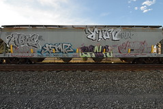 ABUE ? KERVZ RINO BANK AEBOL (TheGraffitiHunters) Tags: graffiti graff spray paint street art colorful freight train tracks benching benched abue hopper floater floaters aebol kervz bank rino