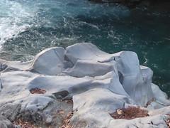 Polished stones (seikinsou) Tags: japan nikko spring kanmangafuchi abyss gorge walk jizo statue red hat bib path daiyagawa river stone water