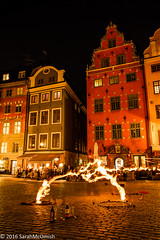 Moving at the speed of light (sarahmcomish) Tags: stockholm old town fire night architecture dancer square city life street scene