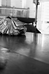 Phonebook (The BenMiller) Tags: black white blackandwhite bw bnw sony a7r sonya7r sonyimages sonyphotography photoshop adobe cc detail shadows contrast phonebook phone book discard discarded forgotten urban