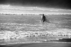 5819.2 Black Suit Wading B&W (eyepiphany) Tags: beach oregon manzanita oldgrowth smugglerscove lonesurfer oswaldstatepark inharmsway oregonbeaches manzanitaoregon shortsandsbeach headingout summerlife shortsandbeach oregontourism surfingspot bestplacestosurf bestplacestosurfinoregon oregonbeachtowns hotsurfingspots
