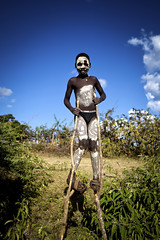 Bana on stilts - Ethiopia (Steven Goethals) Tags: travel shadow portrait people face canon bena eos child culture tribal adventure peoples explore human valley whip tribes omovalley 5d stick tradition ethiopia tribe bana tribo visage hamer whipped ethnology tribu omo banna eastafrica etiopia ethiopie blackskin benna ethnique keyafer ethiopi goethals afriquedelest bulljump mygearandme stevengoethals