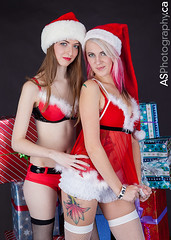 Santa's sexy little helpers are ready to make this the best Christmas ever. (andreas_schneider) Tags: santa christmas xmas pink girls woman flower sexy smile hat cane tattoo female laughing fur fun model candy teddy young fishnet tights presents pinup