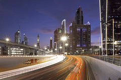 Sheikh Zayed Road @ night, Dubai, UAE (axelschmies photography) Tags: road city houses house building tower skyline architecture modern night skyscraper buildings evening photo persian high downtown dubai cityscape fuji exterior gulf view shot traffic time photos shots outdoor united towers uae cityscapes nobody arabic east emirates story nighttime photographs photograph arab views highrise nights fujifilm arabian 1855 middle rise scape multi rises highrises scapes multistory  exteriors riser highriser risers highrisers xe1 multistoried xtrans