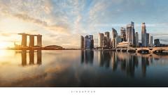 Singapore sunrise (Beboy_photographies) Tags: morning light sun skyline marina sunrise bay sand singapore singapour