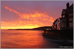First Light. [Explored] (Dave Cappleman) Tags: red sea lighthouse seascape silhouette clouds reflections landscape dawn coast pier seaside colours yorkshire silhouettes whitby sandsend explored abigfave canonefs1855mmis canoneos600d canonrebelt3i dave091260 davecapplemanphotography