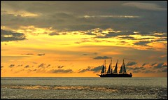 Sailing by..... (david.hayes77) Tags: sunset sea silhouette boat ship sails caribbean stlucia sailingship contrajour castries