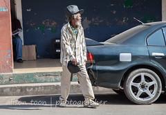 Jamaica-Falmouth-6024 (alison.toon) Tags: street portrait people copyright hat dreadlocks town photographer streetscene jamaica dreads jamaican falmouth rasta rastafarian crossingstreet townlife alisontoon