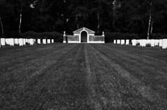 the gatekeeper (WhatEyeZ) Tags: contrast graveyard war worldwar cemetary cross valkenberg tyron sander mierlo